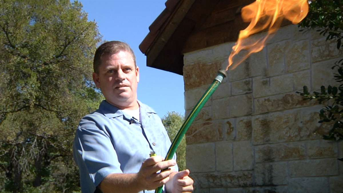 Man with fiery hose