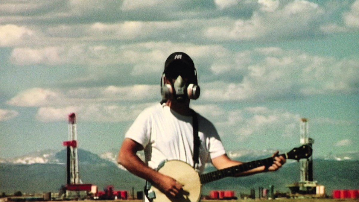 Josh Fox gas mask banjo