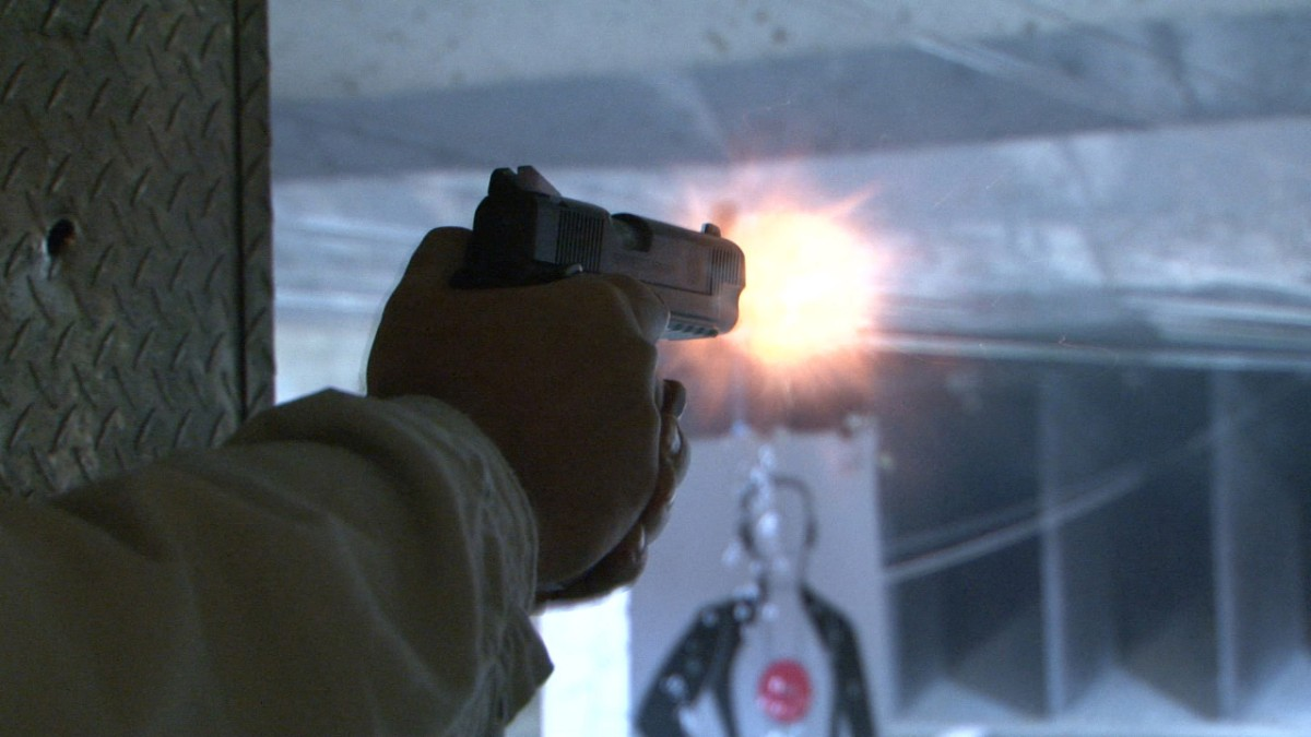 Hand Gun firing at range