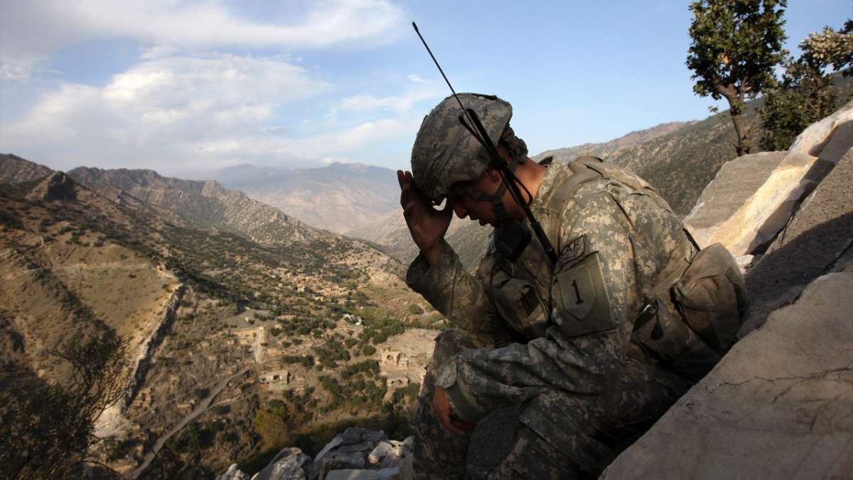 Soldier head down on mountain