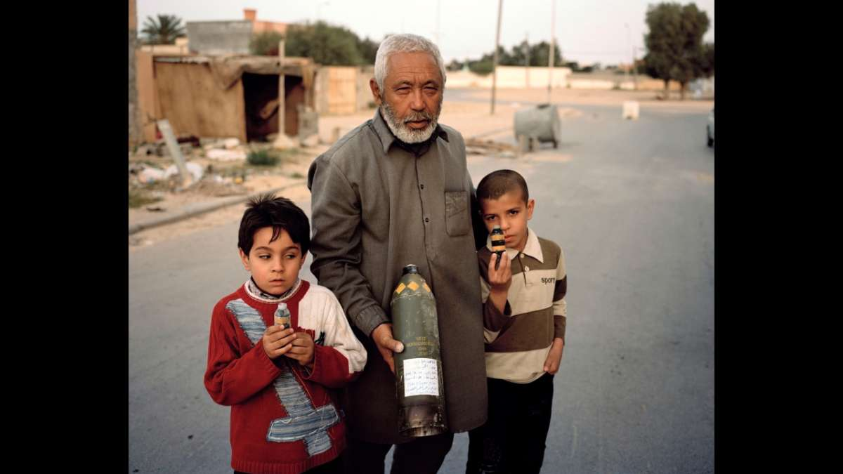 Libyan man with young children with explosives