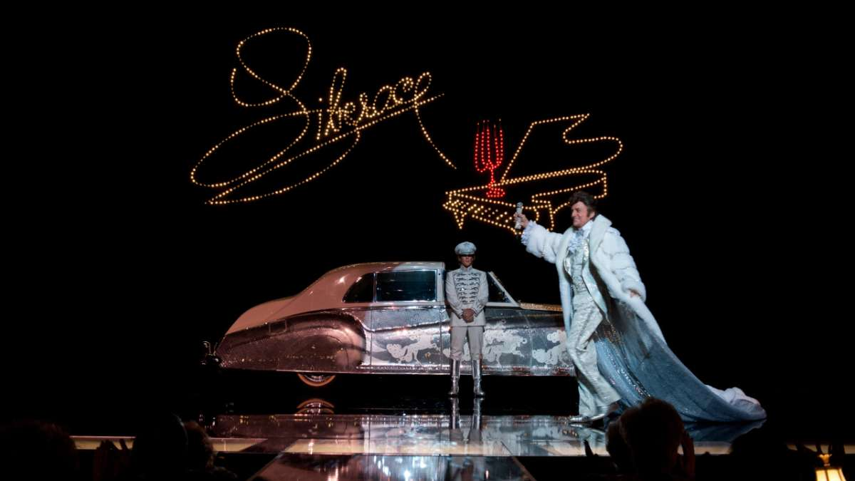 Michael Douglas as Liberace and Matt Damon on stage with car