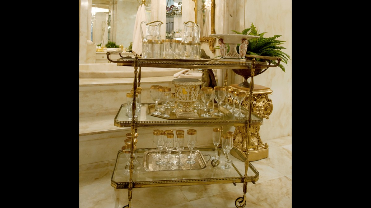 Gilded cart with crystal glasses and decanters