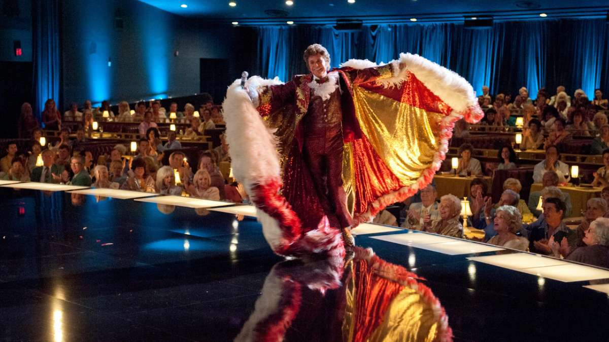 Michael Douglas as Liberace in cape on stage