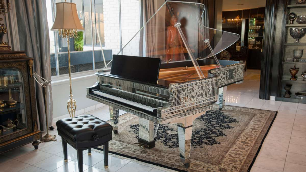 Liberace ornate piano in home
