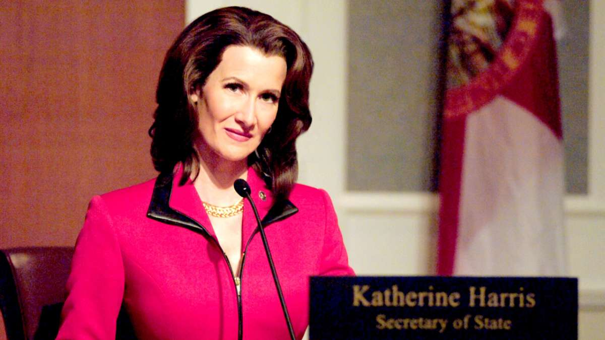 Katherine Harris pink coat microphone in front