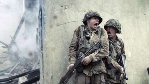 Two soldiers yelling behind wall