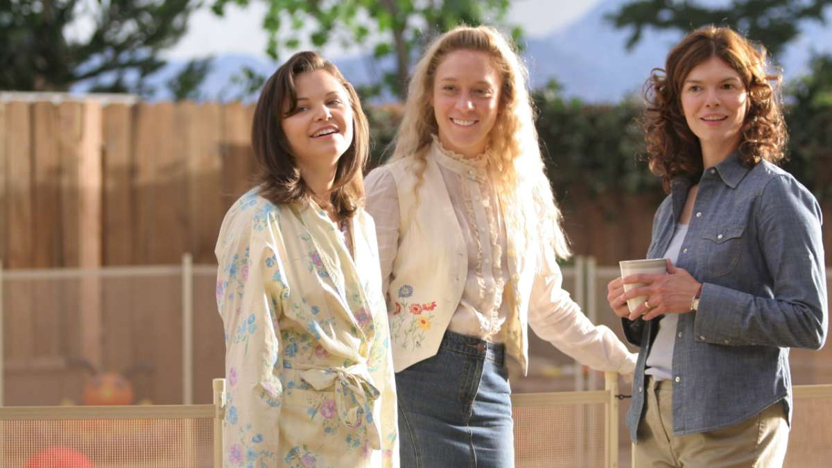 """Margene Heffman, Nicolette Grant and Barbara Henrickson smiling in backyard"""