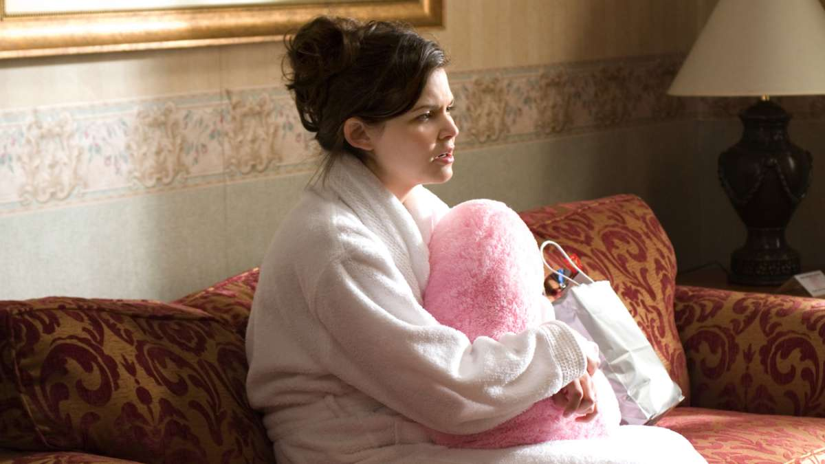 margined Heffman in bathroom hugging pink pillow