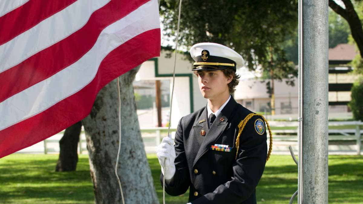 Ben Henrickson in uniform raising flag