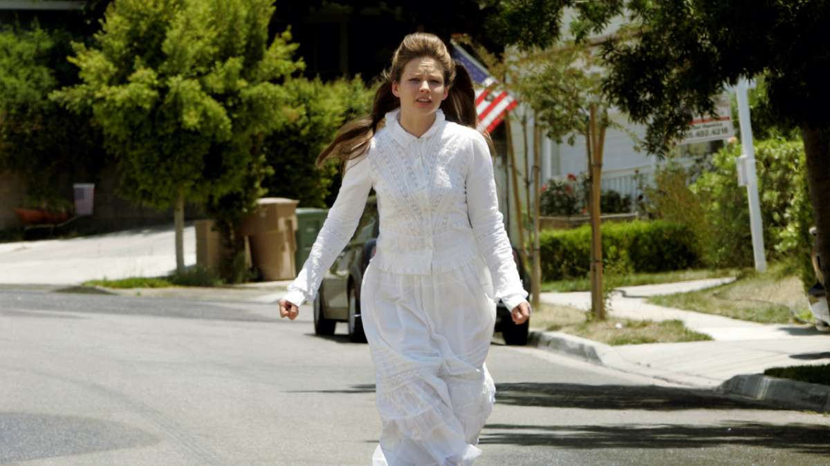 Rhonda Volmer running in white dress