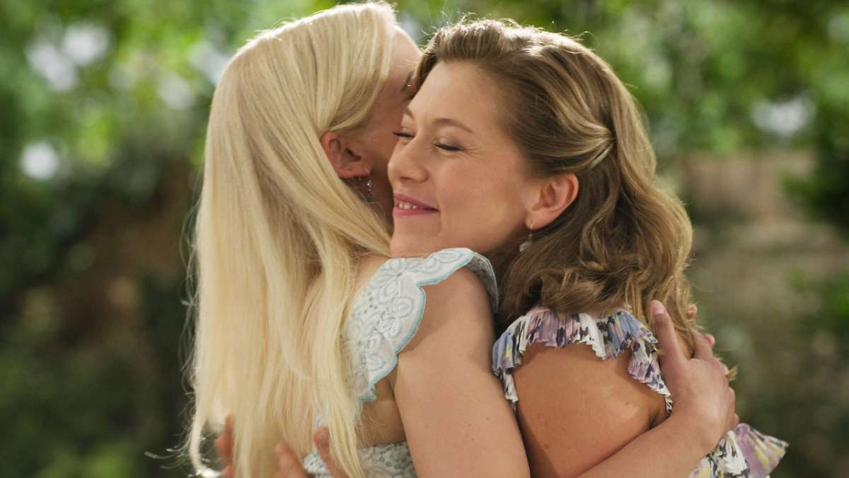 Margene Heffman hugging Ana at wedding