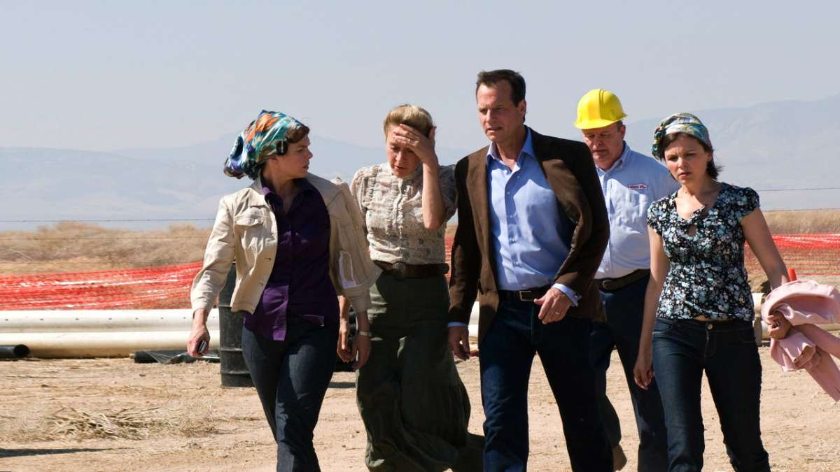 Barbara Bill Henrickson Nicolette Grant Margene Heffman and construction worker walking