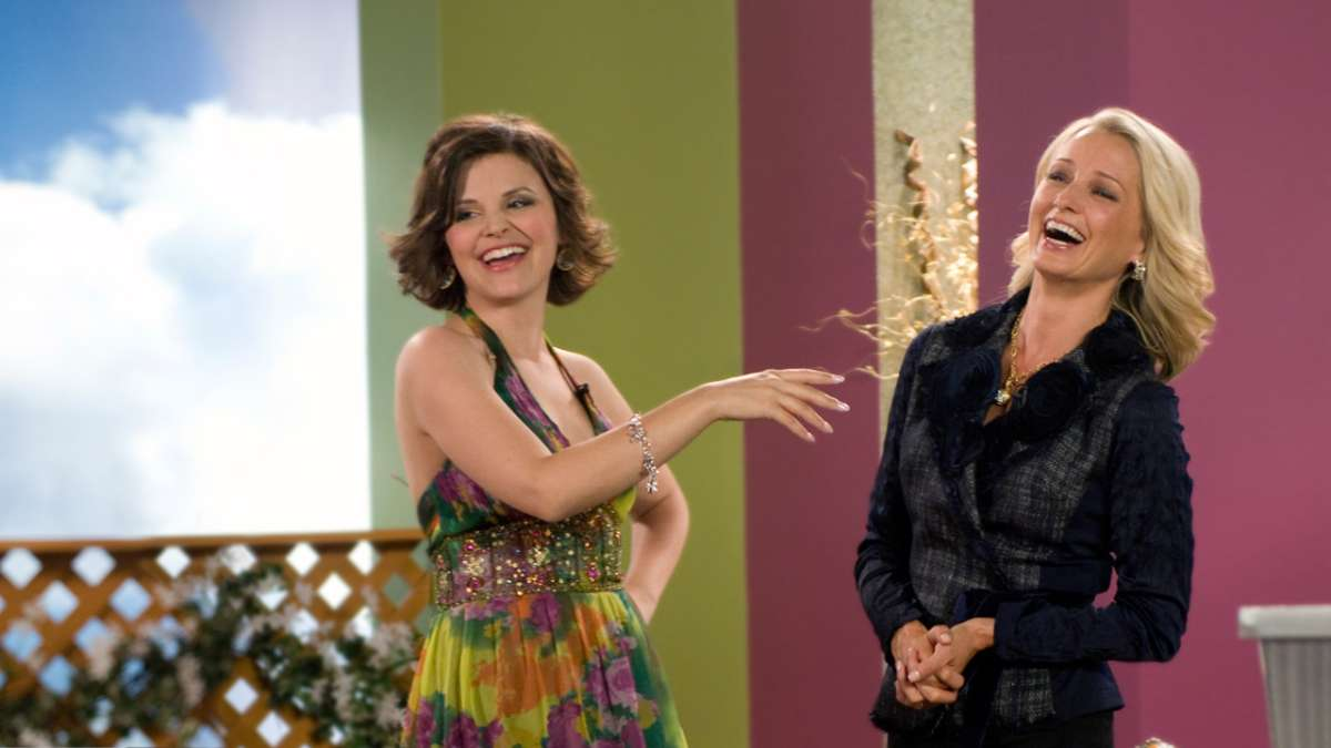 Margene Heffman and woman laughing on studio set