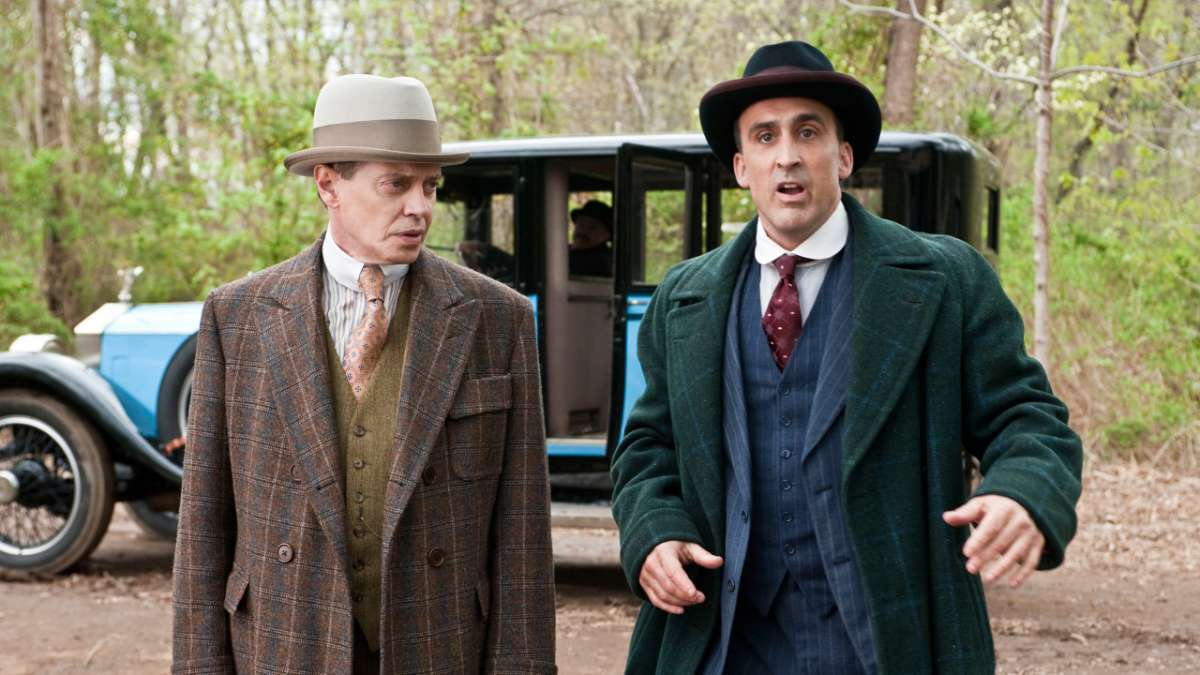 Nucky and ward boss Fleming outside by car