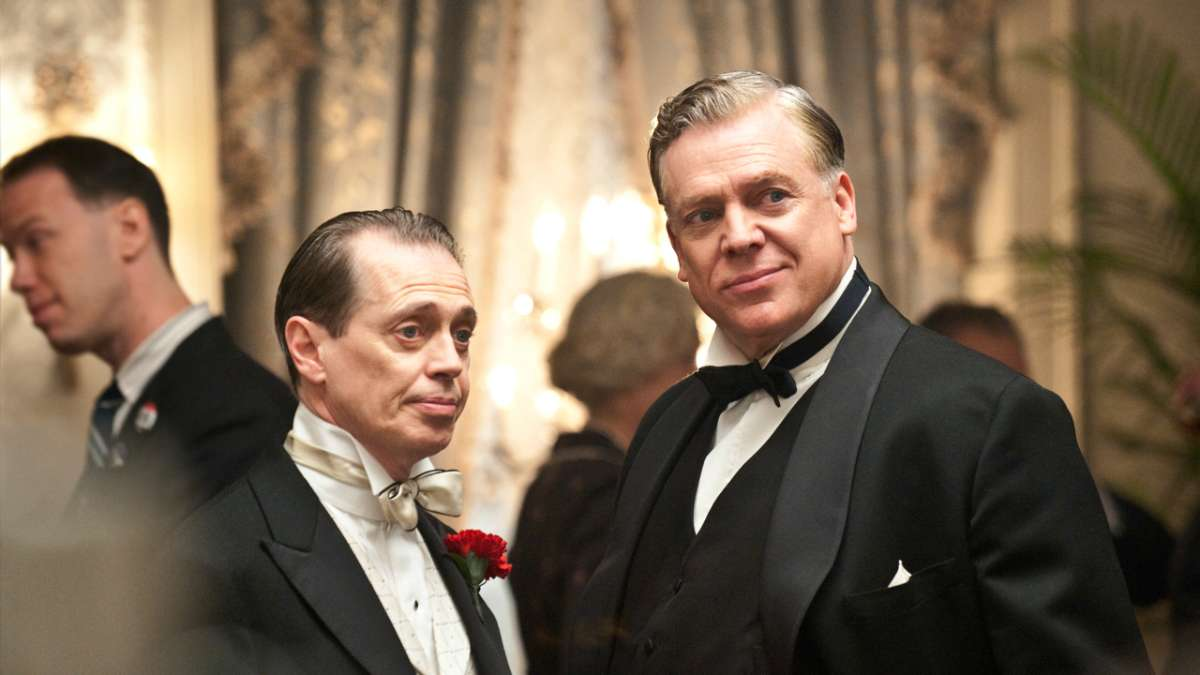 Daughtery and Nucky at party