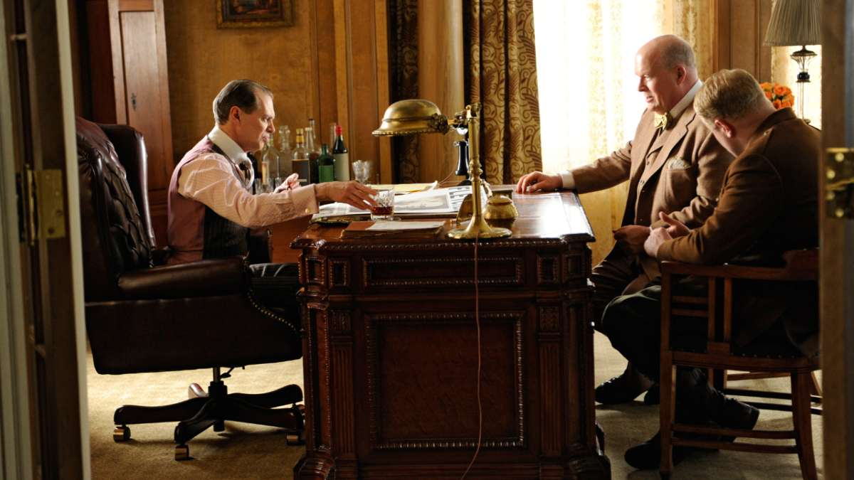 Nucky at desk with his men