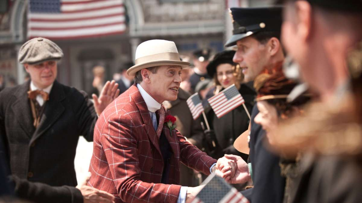 Nucky shaking hands with constituents