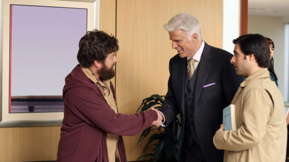 Ray Hueston shakes hands with George Christopher Jonathan Ames
