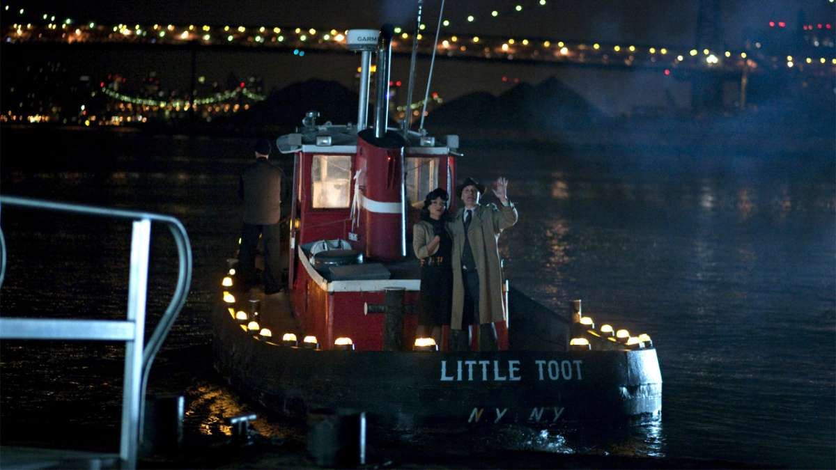 Hee and man on tug boat