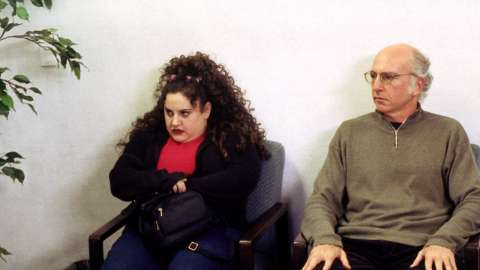 Larry David and woman in waiting room
