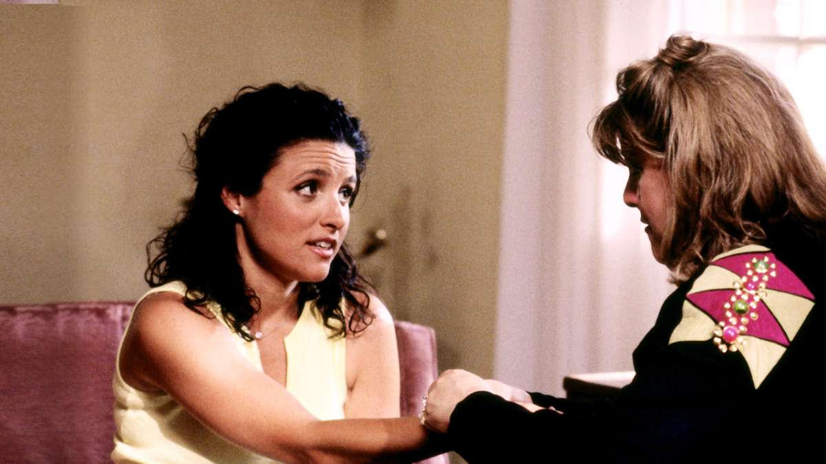 Julia Louis-Dreyfus talking to woman