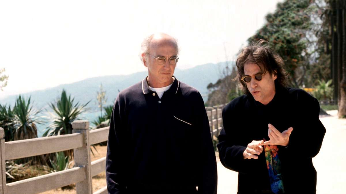 Larry David and Richard Lewis walking outdoors