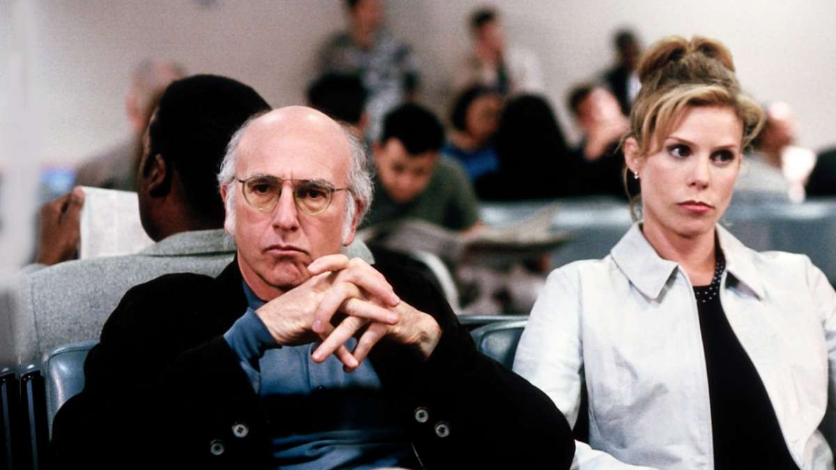 Larry David and Cheryl sitting annoyed expression