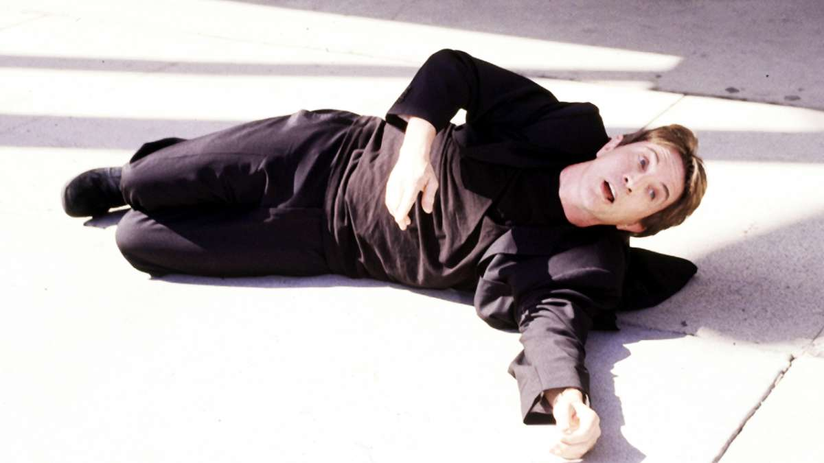 Martin Short laying on sidewalk