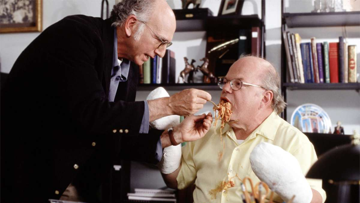 Larry David feeds pasta to man in casts