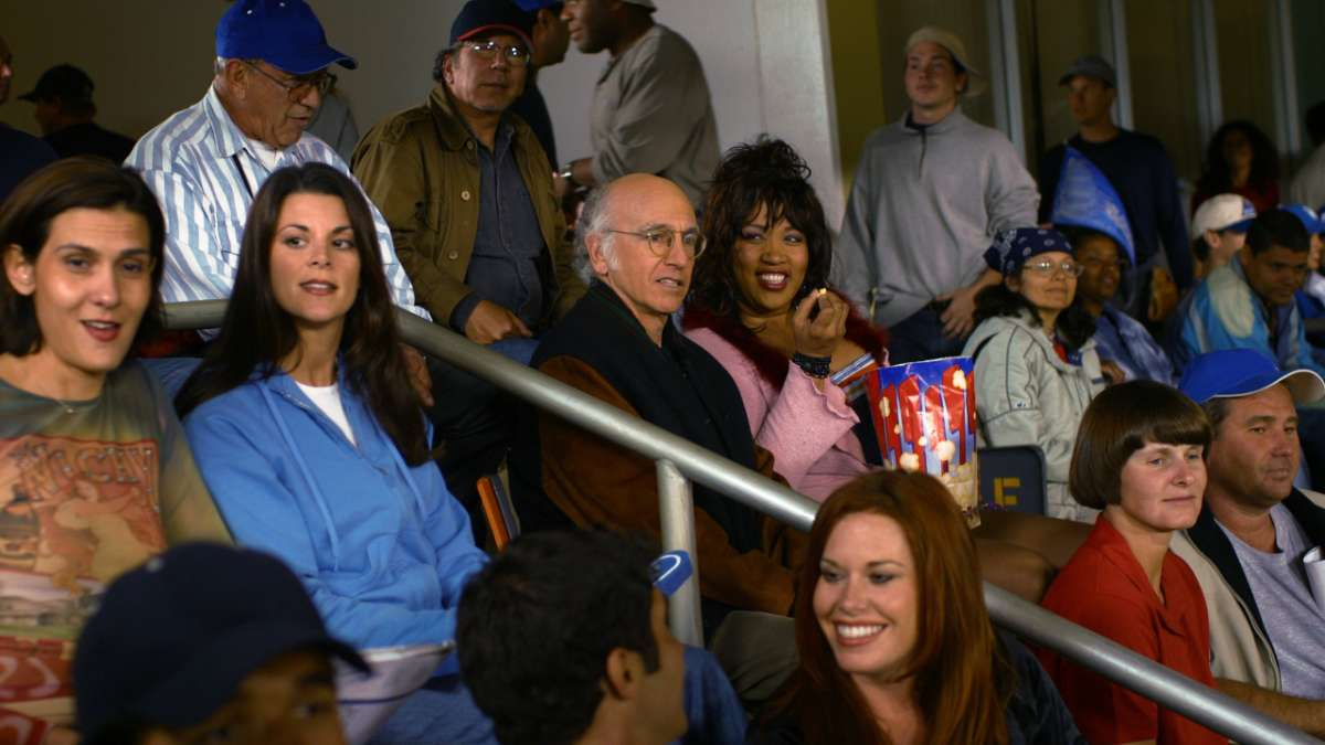 Larry David at baseball game with Monena