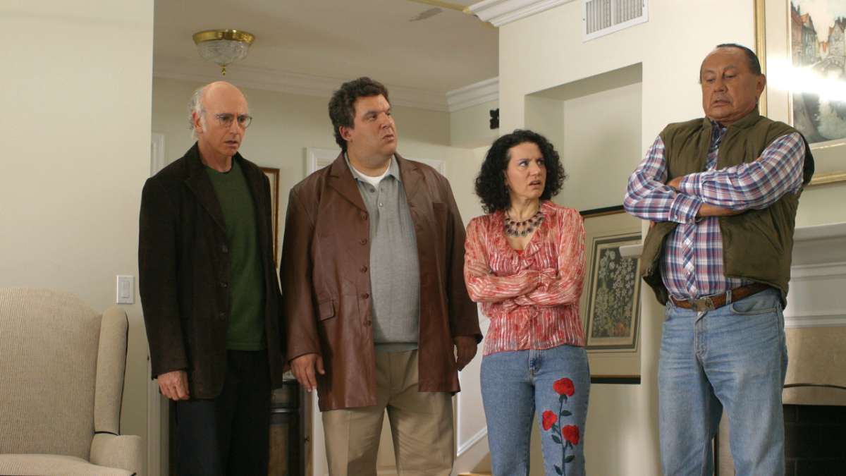 """Larry David, Jeff Greene, Susie Greene and Wandering Bear in living room"""