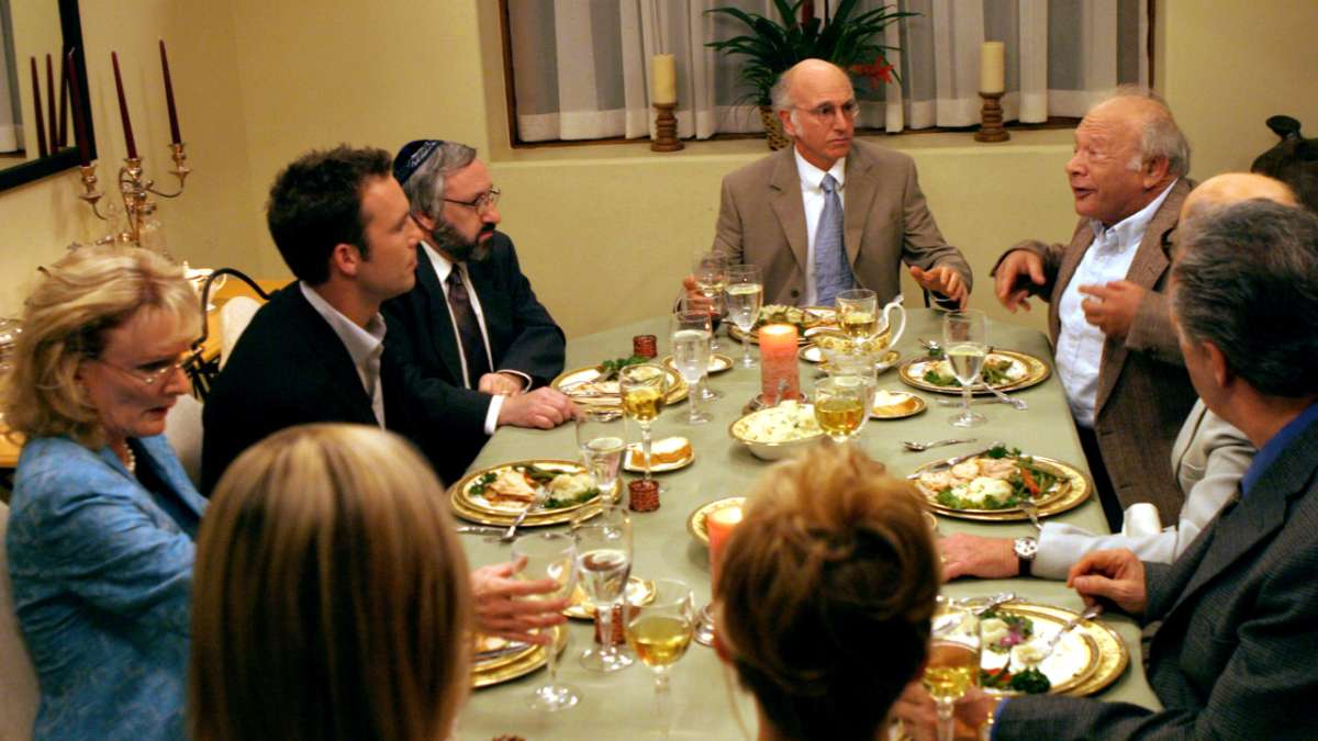 Larry David at head of dinner table family