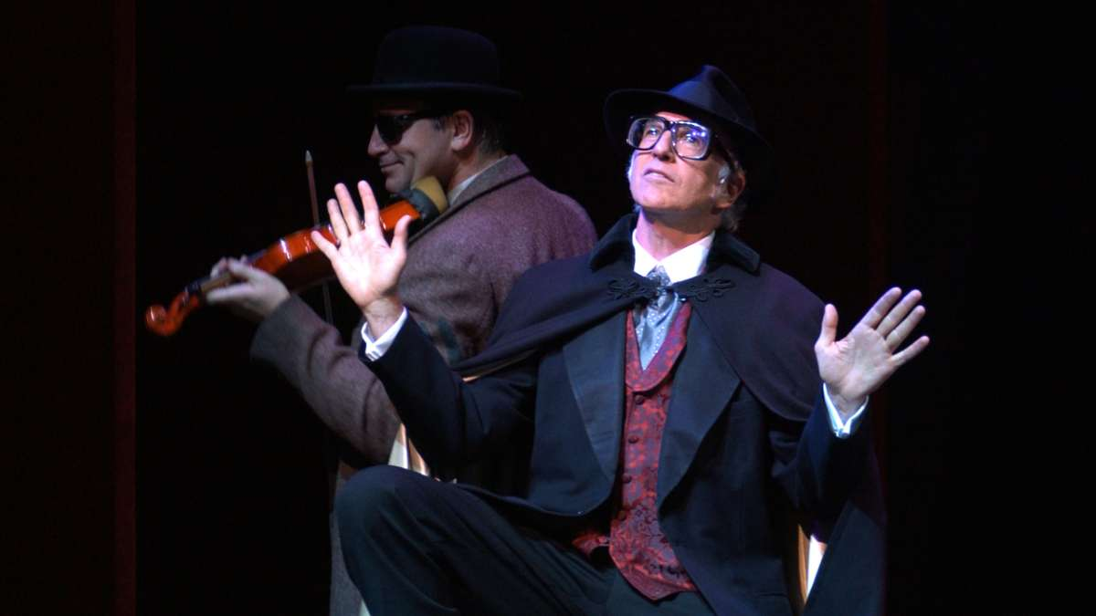 Larry David performing in The Producers with two actresses