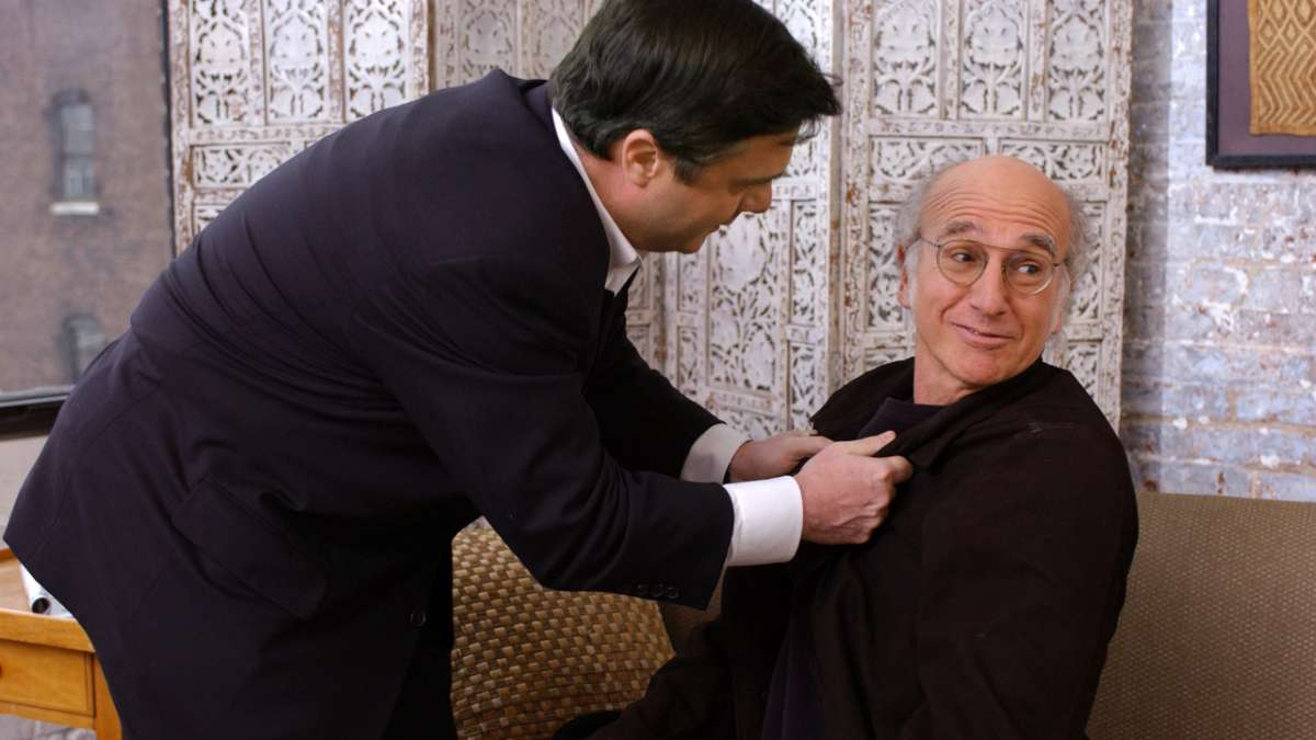Nathan Lane grabs Larry David by lapel
