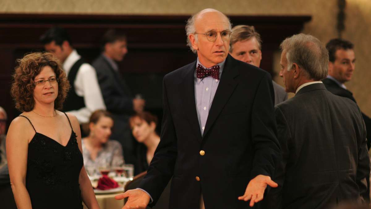 Larry David at formal party woman in black dress