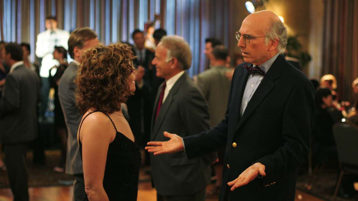 Larry David shrugs to woman at formal party