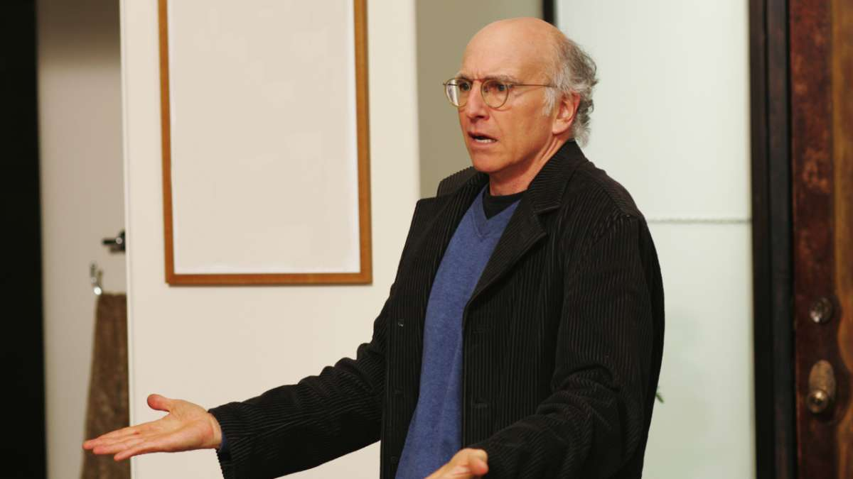Larry David shrugs annoyed expression