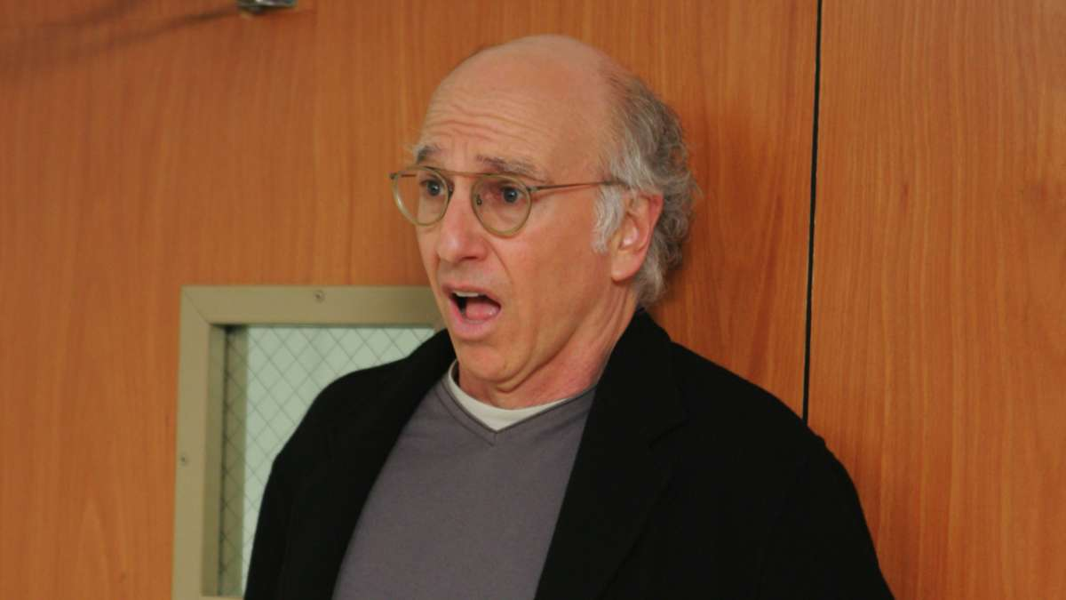 Larry David mouth agape back to door