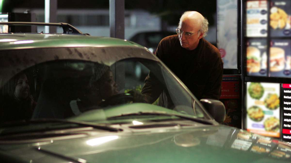 Larry David at drive-through woman in car