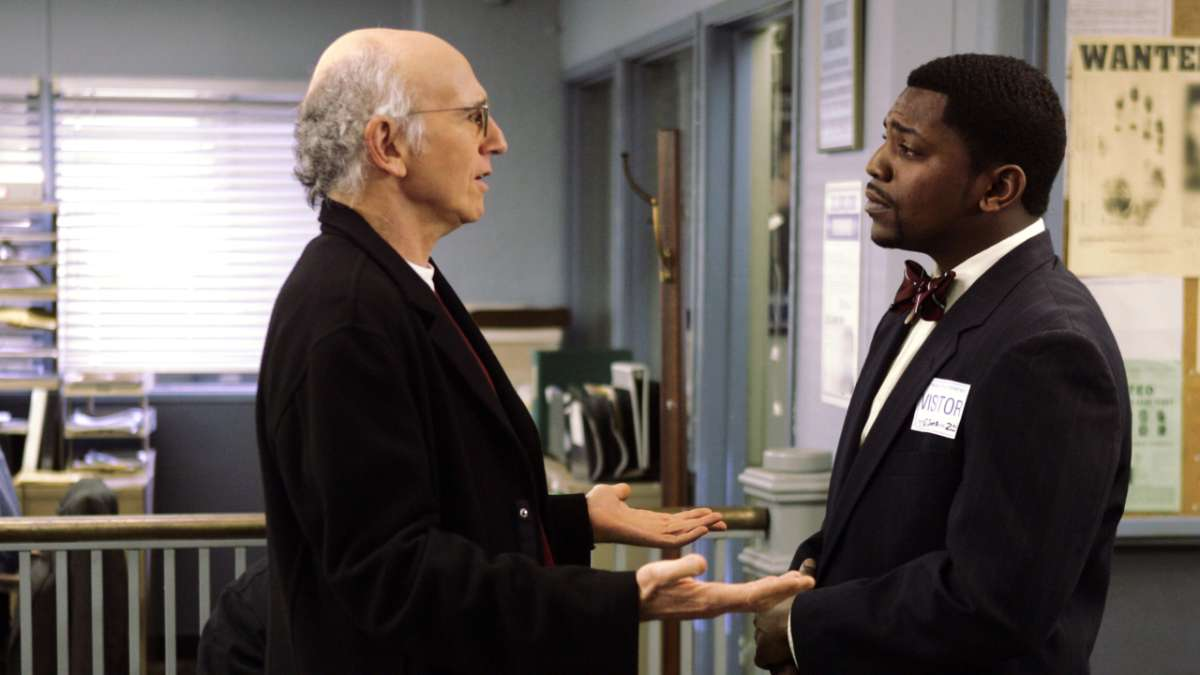 Larry David facing Omar Jones in police station