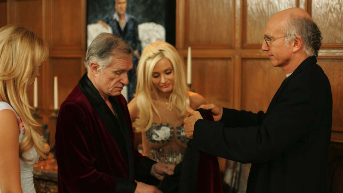 Larry David shows Hugh Hefner a smoking jacket