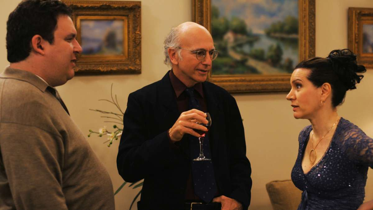 """Jeff Greene, Larry David with wine, and Susie"""