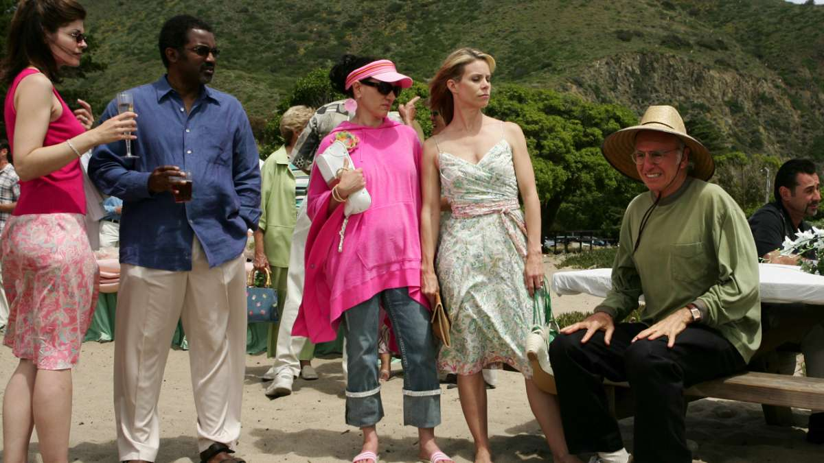 """Susie Greene, Cheryl, Larry David, and others at beach party"""