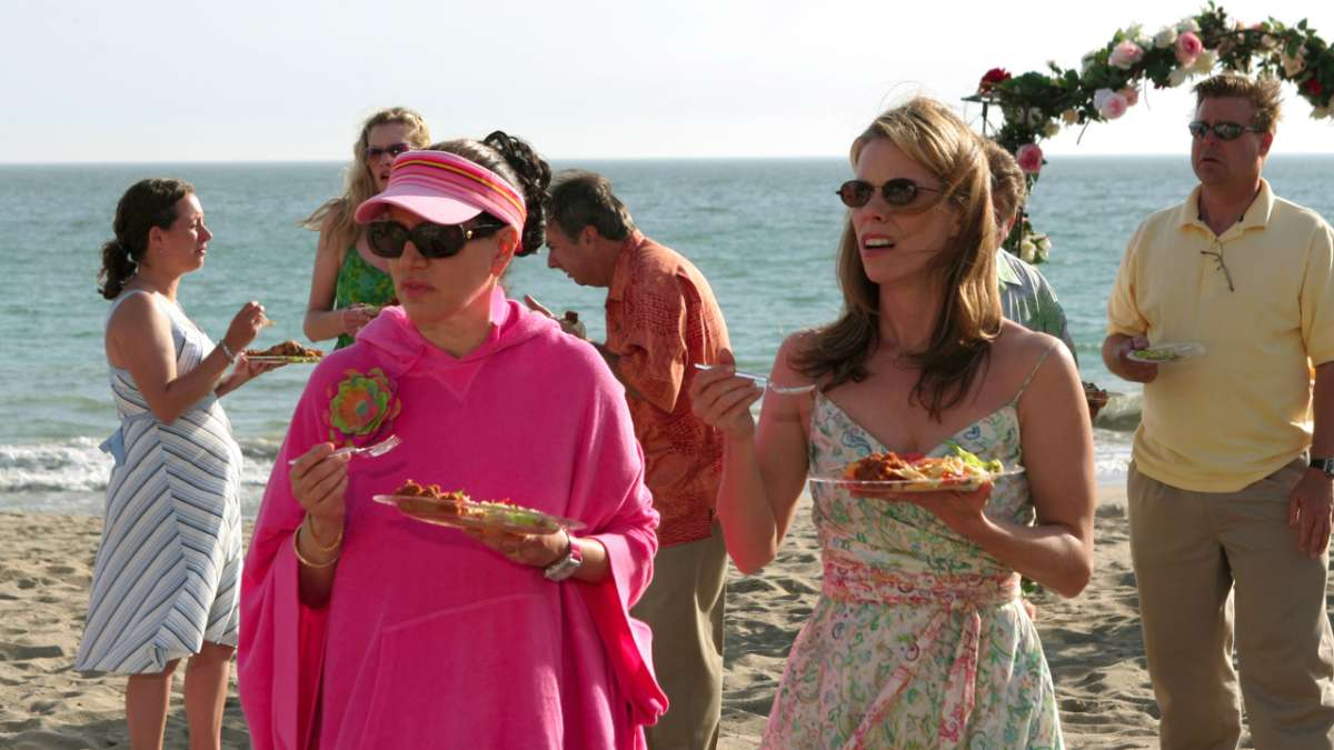 Susie Greene and Cheryl David eating at beach party