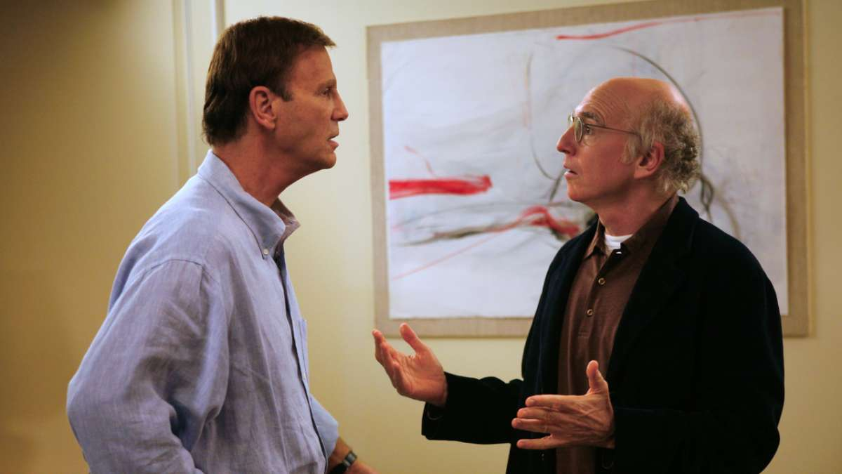 Marty Funkhouser and Larry David artwork behind