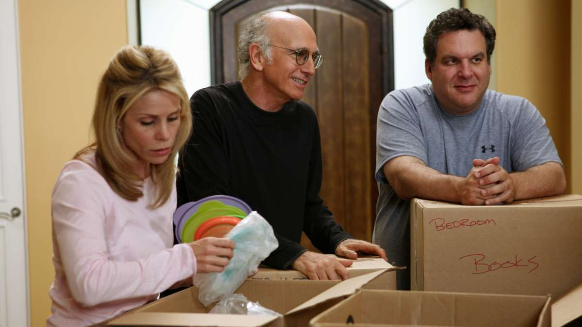 """Cheryl, Larry David, Jeff Greene packing moving boxes"""