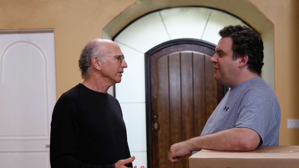 Larry David and Jeff Greene moving boxes