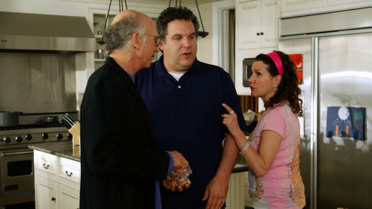 """Larry David, Jeff Greene, and Susie in kitchen"""