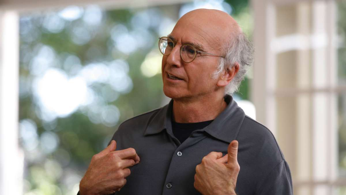 Larry David pointing to himself with both hands